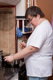 Mentally disabled woman is cooking Royalty Free Stock Photo