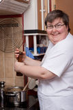 Mentally disabled woman is cooking Royalty Free Stock Image