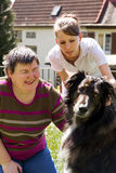 Mentally disabled woman with a dog. Disabled women is making a animal-assisted therapy Stock Images