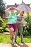 Mentally disabled woman is doing some assisted exercises. Mentally disabled women is doing some assisted exercises for her fitness Royalty Free Stock Photos