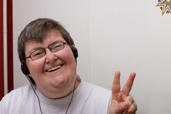 Mentally disabled woman with earphone Royalty Free Stock Image