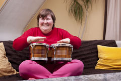 Mentally disabled woman with music therapy. Mentally disabled woman enjoys her music therapy Royalty Free Stock Image