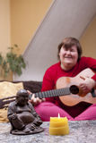 Disabled woman experiences a music therapy Stock Photo