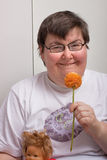 Mentally disabled woman with flower Royalty Free Stock Photography