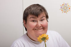 Mentally disabled woman with flower Royalty Free Stock Images