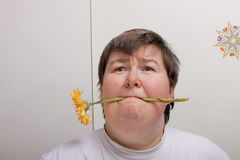 Mentally disabled woman with flower Stock Photo