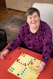 Mentally disabled woman is gaming at home, daily routine stock photos