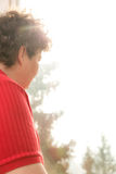 Mentally disabled woman looking out of the window. A mentally disabled woman looking out of the window Stock Photo