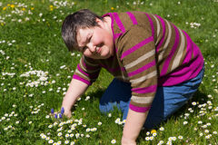 Mentally disabled woman on meadow Royalty Free Stock Images