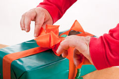 Mentally disabled woman pack or unpack a gift Stock Photo