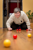 Mentally disabled woman playing with balls, learning and fun Stock Image