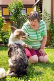 Mentally disabled woman with a second woman and a companion dog. Concept learning by animal assisted living royalty free stock photo