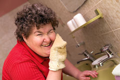 Mentally disabled woman with a washcloth Royalty Free Stock Images