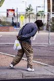 Mentally Ill Homeless Man. A mentally ill homeless man sways from side to side on the sidewalk in the city of Phoenix Stock Photography