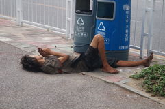 Mentally ill patients lie on the sidewalk. Mentally ill patients lying on the sidewalk, in Shenzhen, china stock photo