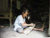 Mentawai women making handcraft in the jungle royalty free stock image