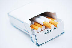 Menthol cigarettes. A pack of cigarettes on a white background stock image