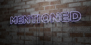 MENTIONED - Glowing Neon Sign on stonework wall - 3D rendered royalty free stock illustration. Can be used for online banner ads and direct mailers Stock Images