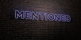 MENTIONED -Realistic Neon Sign on Brick Wall background - 3D rendered royalty free stock image. Can be used for online banner ads and direct mailers Stock Photo