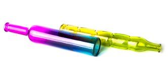 Mentira decorativa hermosa coloreada de dos botellas Foto de archivo libre de regalías