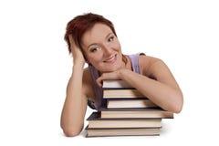 Mentira del estudiante con el libro Fotografía de archivo libre de regalías