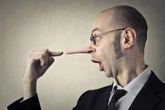 Mentira del hombre Imagen de archivo libre de regalías