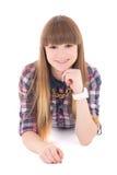 Mentira feliz del adolescente aislada en blanco Imagen de archivo libre de regalías