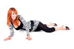 Mentira hermosa de la muchacha en suelo Foto de archivo libre de regalías