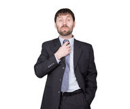 Mentiras da desconfiança dos gestos Linguagem corporal o homem no terno de negócio, endireita seu laço, flertando Isolado no fund Imagem de Stock