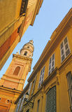 Menton church. View of church and old houses of typical italian style in Menton, Cote d'Azur, France Royalty Free Stock Images