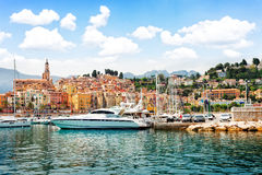 Menton embankment, France. Colorful houses of Menton old town harbor at summer day, France, retro toned Royalty Free Stock Images