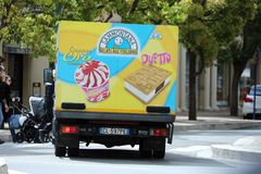 Italian Ice Cream Truck Driving on The Road in The City Center royalty free stock photography