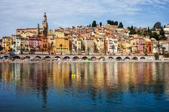Menton Old Town On French Riviera. Menton picturesque old town on French Riviera in France, water reflection in Mediterranean Sea Stock Image