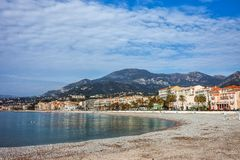 Menton Town on French Riviera in France. Menton town skyline, pebble beach and sea on French Riviera in France, Europe Royalty Free Stock Image