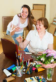 Mentor assesses the work student Royalty Free Stock Photo