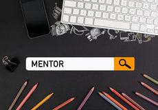 Mentor concept. colorful pencils and a computer keyboard with a mobile phone on a black table Royalty Free Stock Photography
