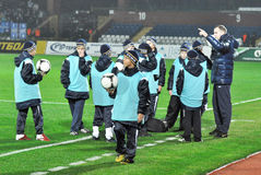 Mentor instructs children. During of warm-up the match between Metallurg (Donetsk City, Ukraine) vs Dnipro (Dnepropetrovsk City, Ukraine) December 01, 2012 Royalty Free Stock Photography