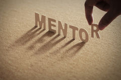 MENTOR wood word on compressed board stock photo