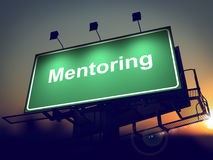 Mentoring - Billboard on the Sunrise Background. Mentoring - Green Billboard on the Rising Sun Background Stock Images