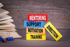 Mentoring concept. Colored wooden blocks on the table Stock Photography
