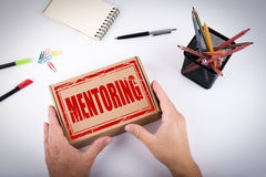 Mentoring concept. Courier delivered  box to the office Royalty Free Stock Photo