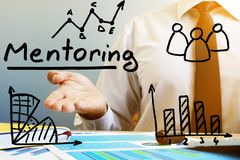Mentoring concept. Mentor at the table in the office. Mentoring concept. Mentor at the table in an office royalty free stock images