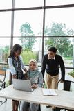 Mentoring female employees by more experienced department head witnessed by CEO. Of the company royalty free stock images