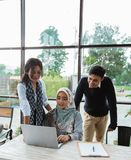 Mentoring female employees by more experienced department head witnessed by CEO. Of the company royalty free stock photo