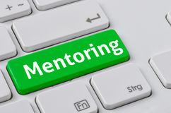 Mentoring. A keyboard with a green button - Mentoring royalty free stock images