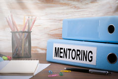 Mentoring, Office Binder on Wooden Desk. On the table colored pencils, pen, notebook paper Stock Photo