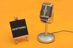 Mentoring sign with microphone motivation concept Stock Photo