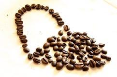 Mentre caffè bevente Immagini Stock