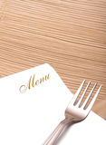 Menu. Empty menu card paper with fork on wooden plate Royalty Free Stock Photography