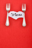 Menu. Card with forks on red stripe background royalty free stock photo
